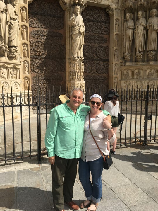 Abie Inger (right) and Kim Slaton stand in front of Notre Dame Cathedral in Paris.