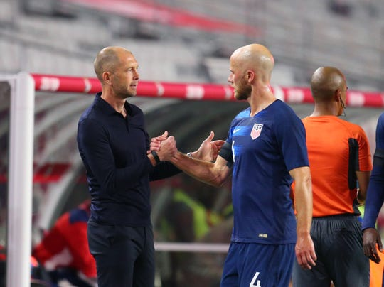 USA head coach Gregg Berhalter (left) greets midfielder Michael Bradley after being pulled from the game against Panama during an international friendly soccer match at State Farm Stadium.