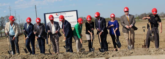 Those taking part in groundbreaking ceremonies for Liberty Township's new administration building were, from left: Todd Terry, Nestor Melnyk, Justin Conger, RandyTerry, Steve Schramm, Christine Matacic, Pam Quinlisk, Tom Farrell, Kristen Bitonte, Rick Jones, and Lt. Morgan Dallman