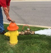 A Clarksville Gas & Water worker tests and flushes a fire hydrant. Annual citywide hydrant testing began this week.