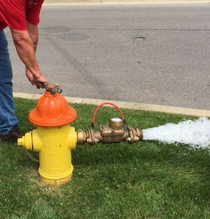 Opening a fire hydrant is how crews flush water lines.