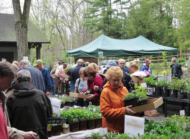 Visitors to Leonard J. Buck Garden celebrate spring at the Annual Earth Day Celebration and Plant Sale.