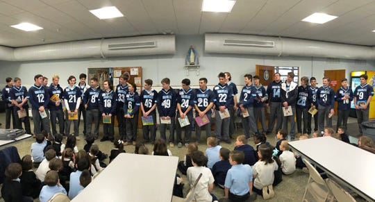 Immaculata High School boys lacrosse team and Immaculate Conception School kindergartners and first graders.