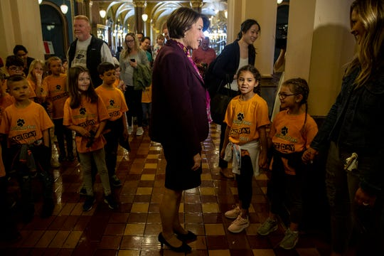 U.S. Sen. Amy Klobuchar, D-Minn., stops to talk with a group of studnets touring the Iowa State Capitol on Thursday, April 18, 2019, in Des Moines. The presidential hopeful spent the morning meeting with legislators and staff at the capitol.