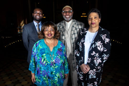 Rep. Ras Smith, D-Waterloo, Rep. Ako Abdul-Samad, D-Des Moines, Rep. Ruth Ann Gaines, D-Des Moines and Rep. Phyllis Thede, D-Bettendorf stand together for a photo inside the Iowa State Capitol on Monday, April 15, 2019, in Des Moines. Of the 150 lawmakers in Iowa's congress, these four are the only people of color.