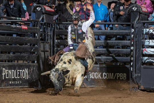 Tye Chandler attempts to ride Circuit Breaker  of Julio Moreno / Dallas Schott during the Round 1 of the PBR Pendleton Whisky Velocity Tour event in Fresno, CA. Photo by Andre Silva