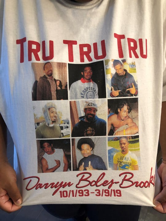 Family of Darryn Boles-Brooks show the T-shirt they made in memory of him.