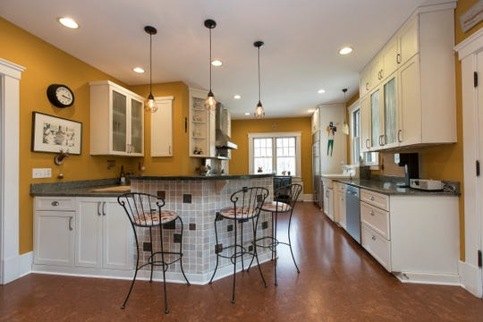 A major renovation that removed one load bearing wall created this large kitchen. A bench was built into one corner as informal eating space for the large family. Appliances are Viking, Sub-Zero and Bosch.