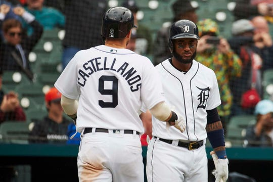 Tigers right fielder Nicholas Castellanos receives congratulations from first baseman Niko Goodrum after scoring in the seventh inning against the White Sox on Thursday, April 18, 2019, at Comerica Park.