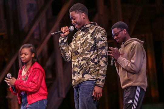 Tyronne Green, Asonta Hargrove and Channel Braxton, of John Glenn High School perform a Benjamin Franklin rap on stage during the Hamilton Education Program at the Fisher Theatre in Detroit on Thursday, April 18, 2019. The program started with funding from The Rockefeller Foundation engages students in American History curriculum focusing on the founding fathers and Alexander Hamilton.