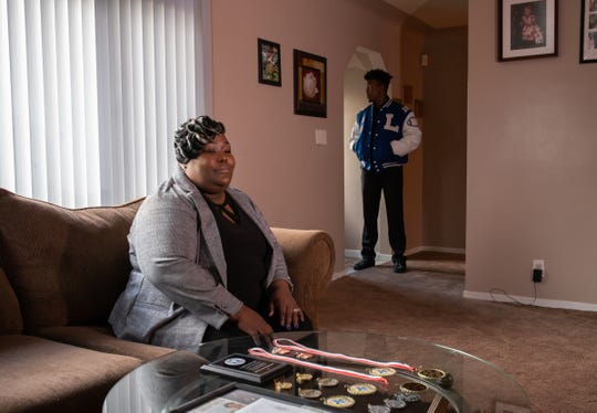 Lakeview High School senior Delorean Ishmon II and his mother Melvenna Fant-Jones, 36, pose for a photo at their home in Eastpointe on Monday, February 5, 2019.