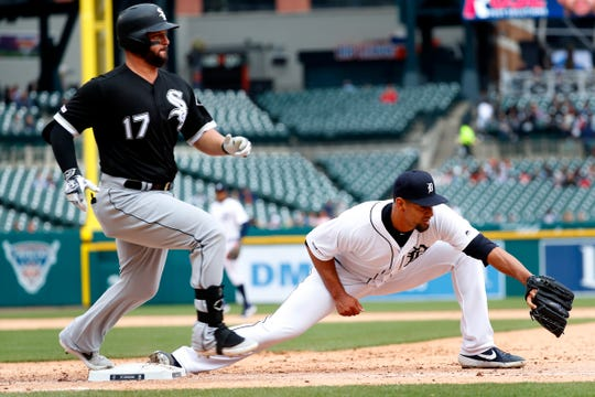White Sox designated hitter Yonder Alonso beats the throw to Tigers pitcher Tyson Ross, covering first base in the sixth inning on Thursday, April 18, 2019, at Comerica Park.