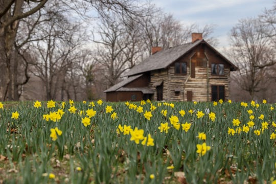 The historic log cabin's exterior was recently renovated at Palmer Park in Detroit on Tuesday, April 16, 2019.