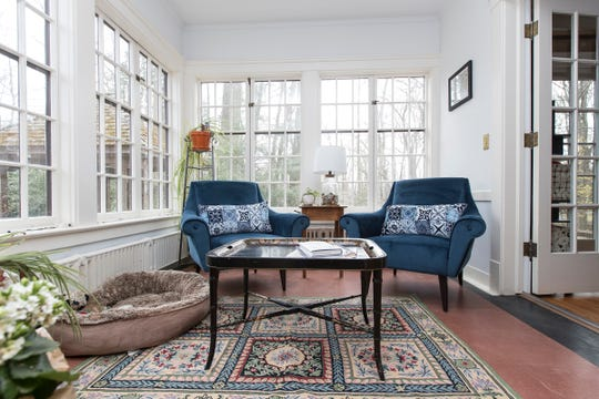Four of the major bedrooms have attached sleeping porches like this one. Predating air conditioning, these attached rooms let residents move out in summer, open all three sides of windows and sleep in the breeze.