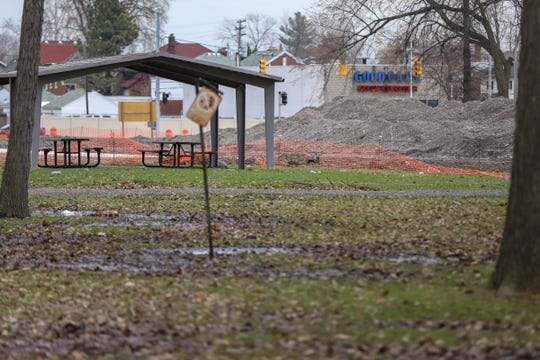 Mounds of gravel can be seen in a construction area where the tennis courts were recently torn down at Palmer Park in Detroit on Tuesday, April 16, 2019.