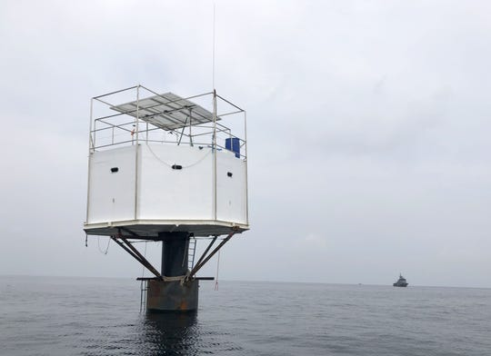 A floating dwelling, 12 nautical miles off the coast of Phuket, Thailand, is part of a controversy involving a Michigan native and his girlfriend.