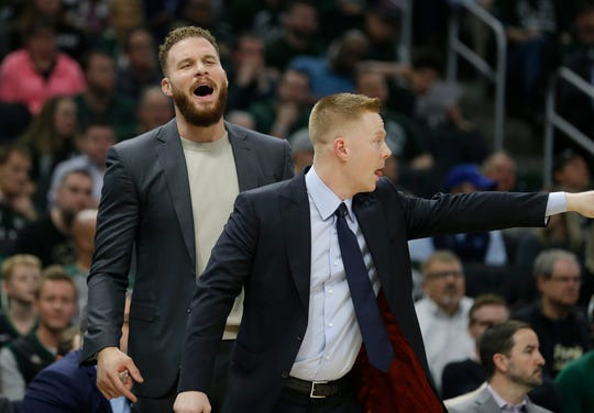 Detroit Pistons' Blake Griffin, left, and assistant Sean Sweeney react from the bench during the first half of Game 2 of the playoffs against the Milwaukee Bucks on Wednesday, April 17, 2019, in Milwaukee.