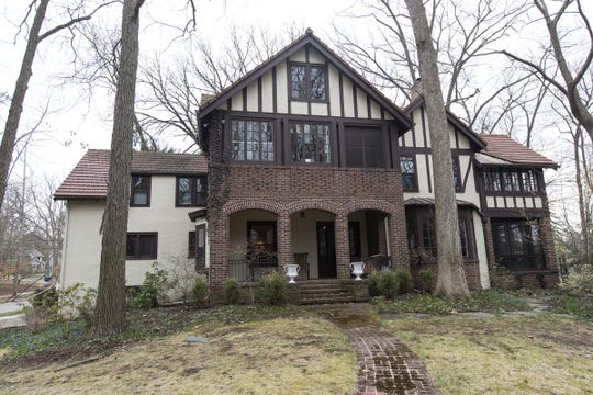 This three-story house, built in an Ann Arbor woods in 1915, still has old-time details of gracious living like four sleeping porches. Past residents included a very early female physician and a Metropolitan Opera baritone. Most recently a large, blended family went tastefully renovated the home.