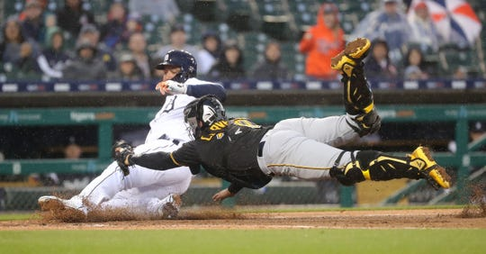 Detroit Tigers' Miguel Cabrera slides safely into home ahead of the tag by Pittsburgh Pirates catcher Francisco Cervelli at first base during the fourth inning Wednesday, April 17, 2019 at Comerica Park in Detroit.