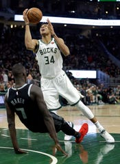 Milwaukee Bucks' Giannis Antetokounmpo collides with Detroit Pistons' Thon Maker and is called for an offensive foul during the second half of Game 2 of the playoffs Wednesday, April 17, 2019, in Milwaukee. The Bucks won 120-99.
