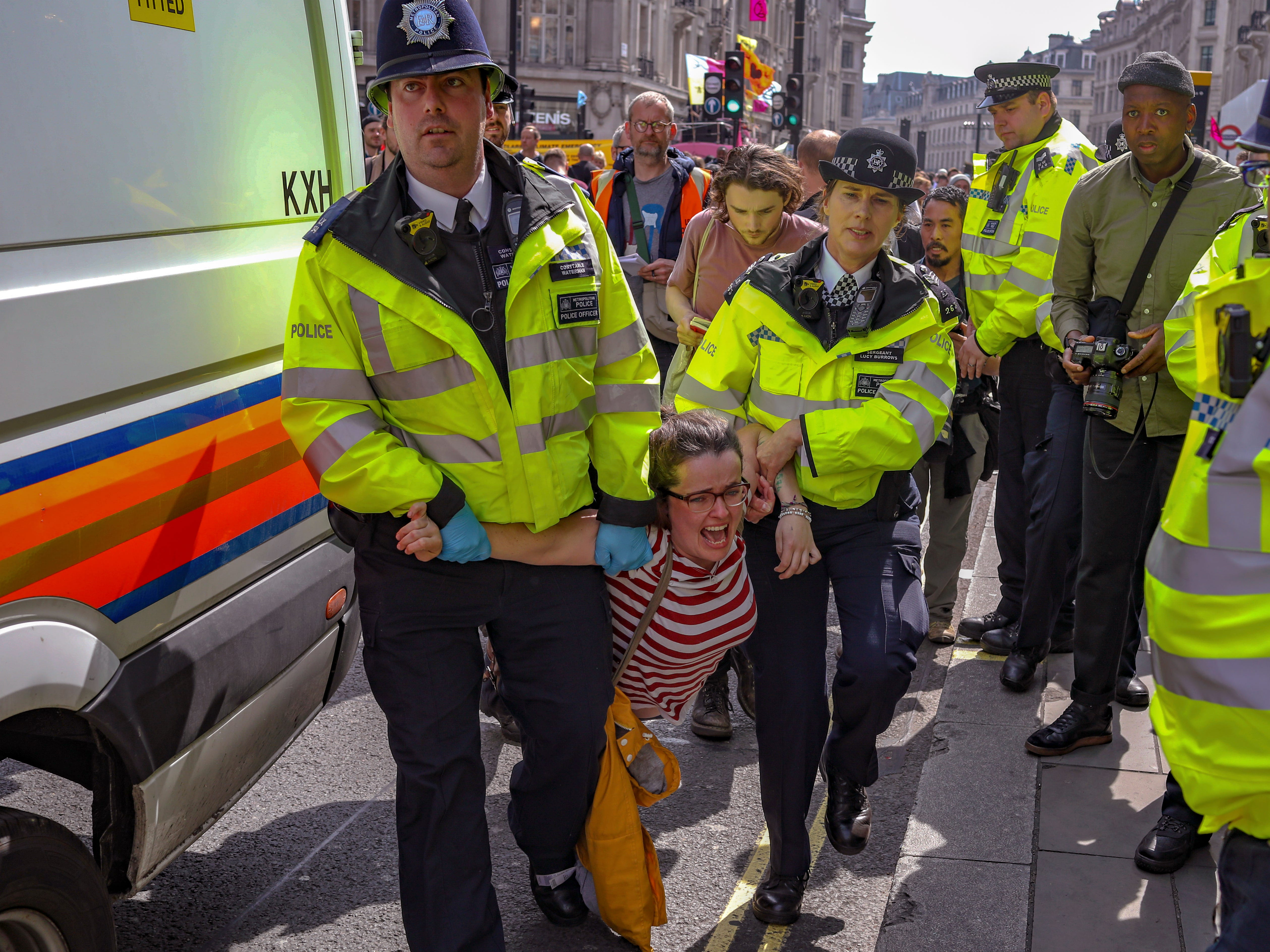 Police arrest protesters as they block traffic on London's Oxford Circus, Thursday, April 18, 2019. The group Extinction Rebellion is calling for a week of civil disobedience against what it says is the failure to tackle the causes of climate change.