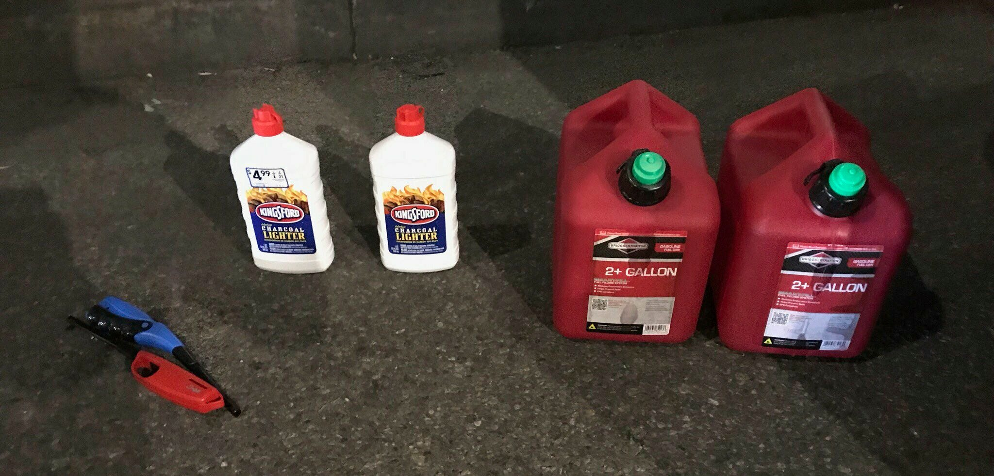 Gas cans and lighter fluid that a New Jersey man was seen carrying as he entered St. Patrick's Cathedral, Wednesday, April 17, 2019, in New York. The suspect has been arrested.