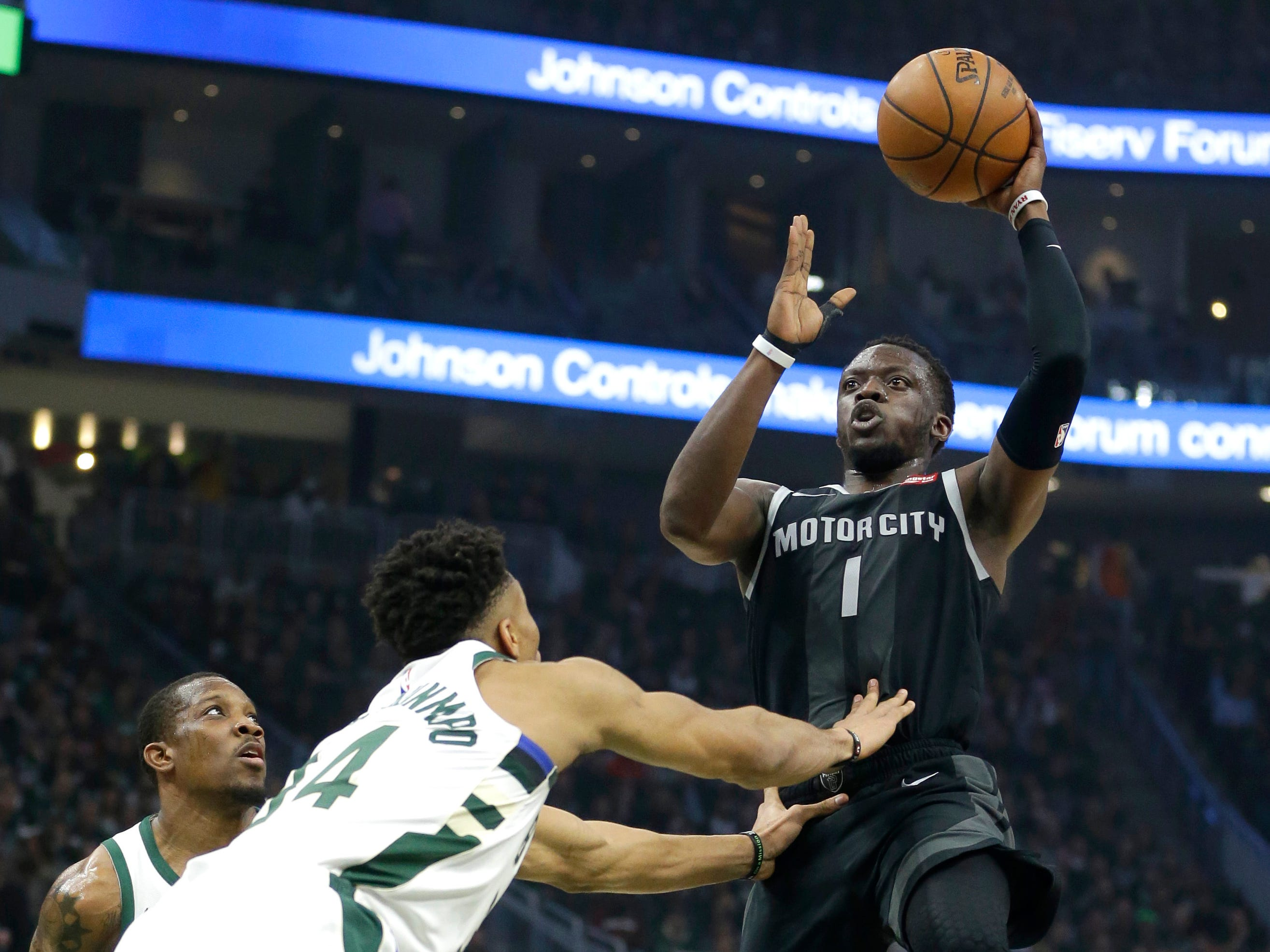 Detroit Pistons' Reggie Jackson (1) shoots against Milwaukee Bucks' Giannis Antetokounmpo during the first half of Game 2 of the NBA first round playoffs in Milwaukee on April 17, 2019. .