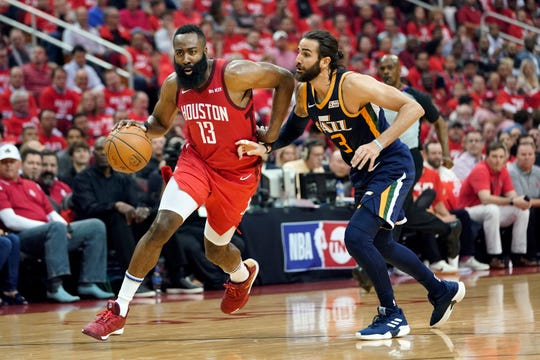 Houston Rockets guard James Harden drives against the Utah Jazz's Ricky Rubio during the first half.