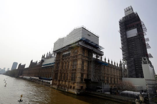 In this photo taken on Wednesday, April 17, 2019, Britain's Houses of Parliament, covered in hoarding and scaffolding as it undergoes restoration work to repair the crumbling building, in London.