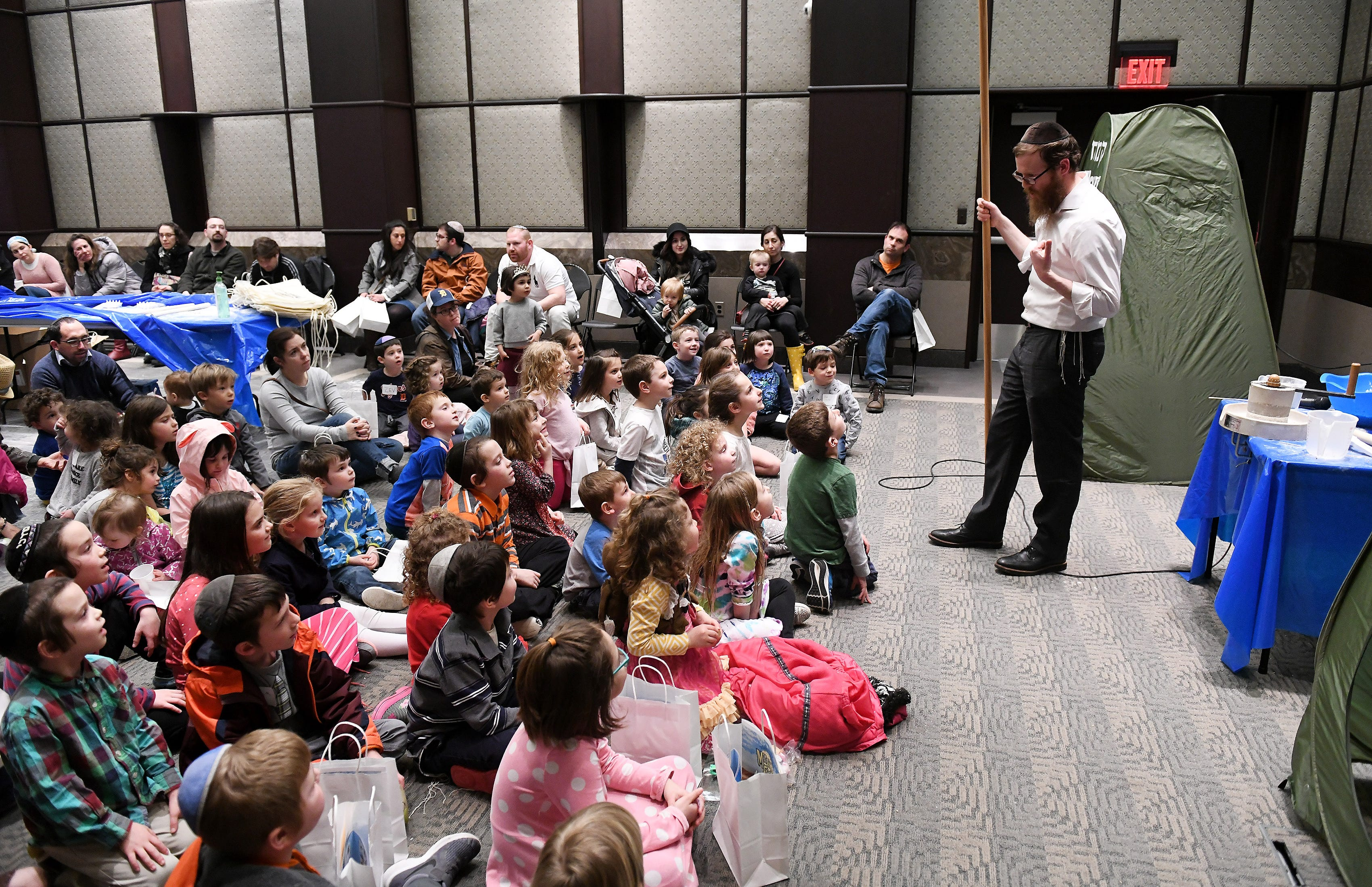 Rabbi Shneur Silberberg of Bais Chabad of West Bloomfield teaches children about how matzah is made at the Matzah Factory Extravaganza at the Jewish Community Center in West Bloomfield.