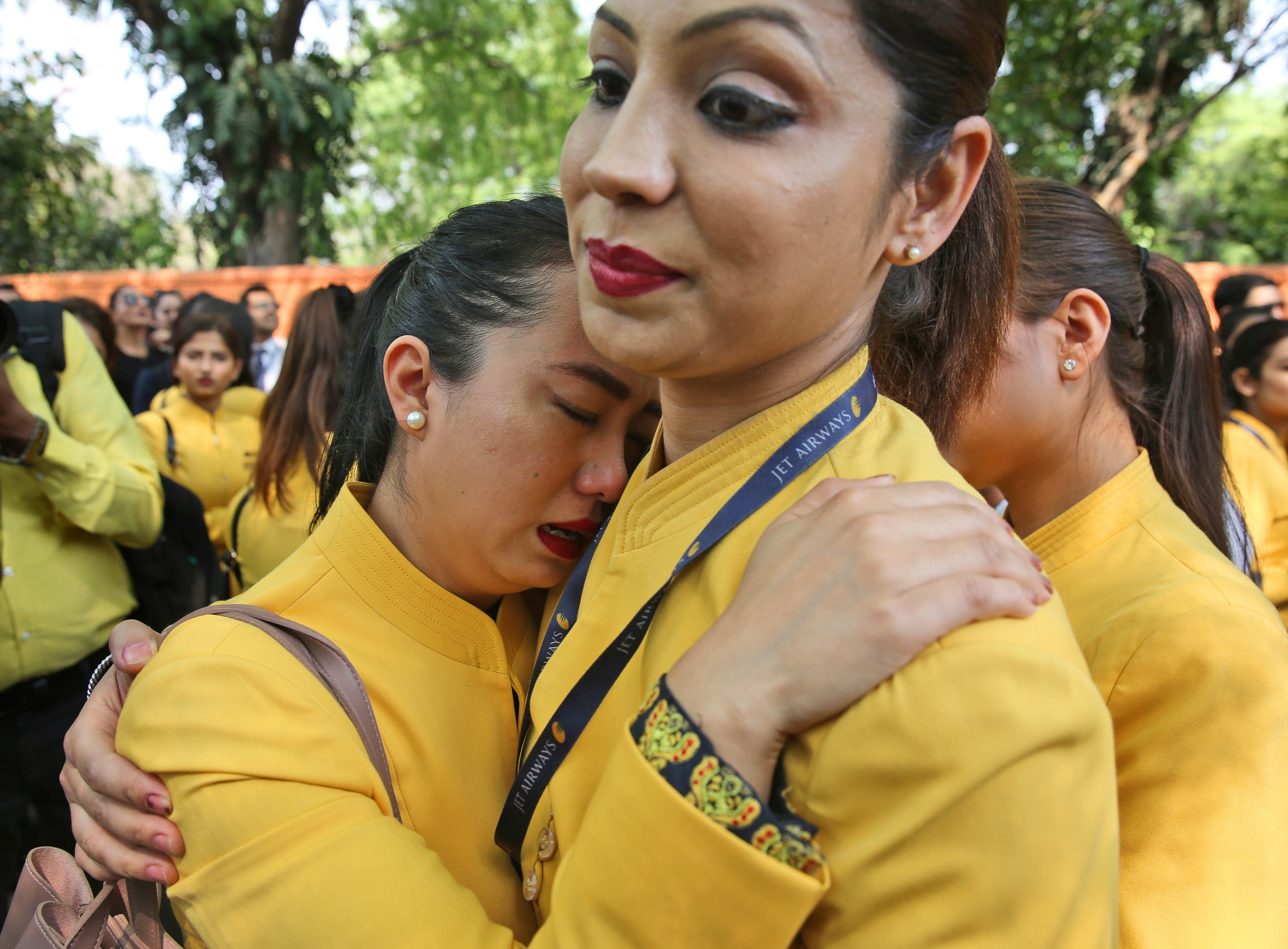 """An employee of Jet Airways cries as she joins colleagues in a gathering to appeal to the government to save their company, in New Delhi, India, Thursday, April 18, 2019. Creditors of India's beleaguered Jet Airways say that they are """"reasonably hopeful"""" that a bidding process with potential investors for a controlling stake in the airline will save the company."""