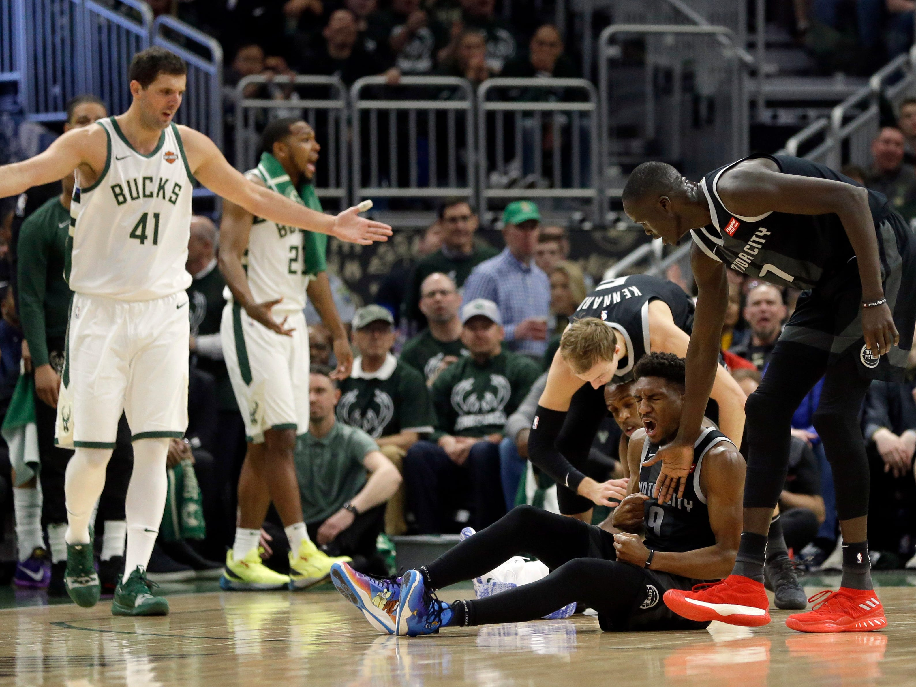 Detroit Pistons' Langston Galloway reacts after drawing a charge during the first half.