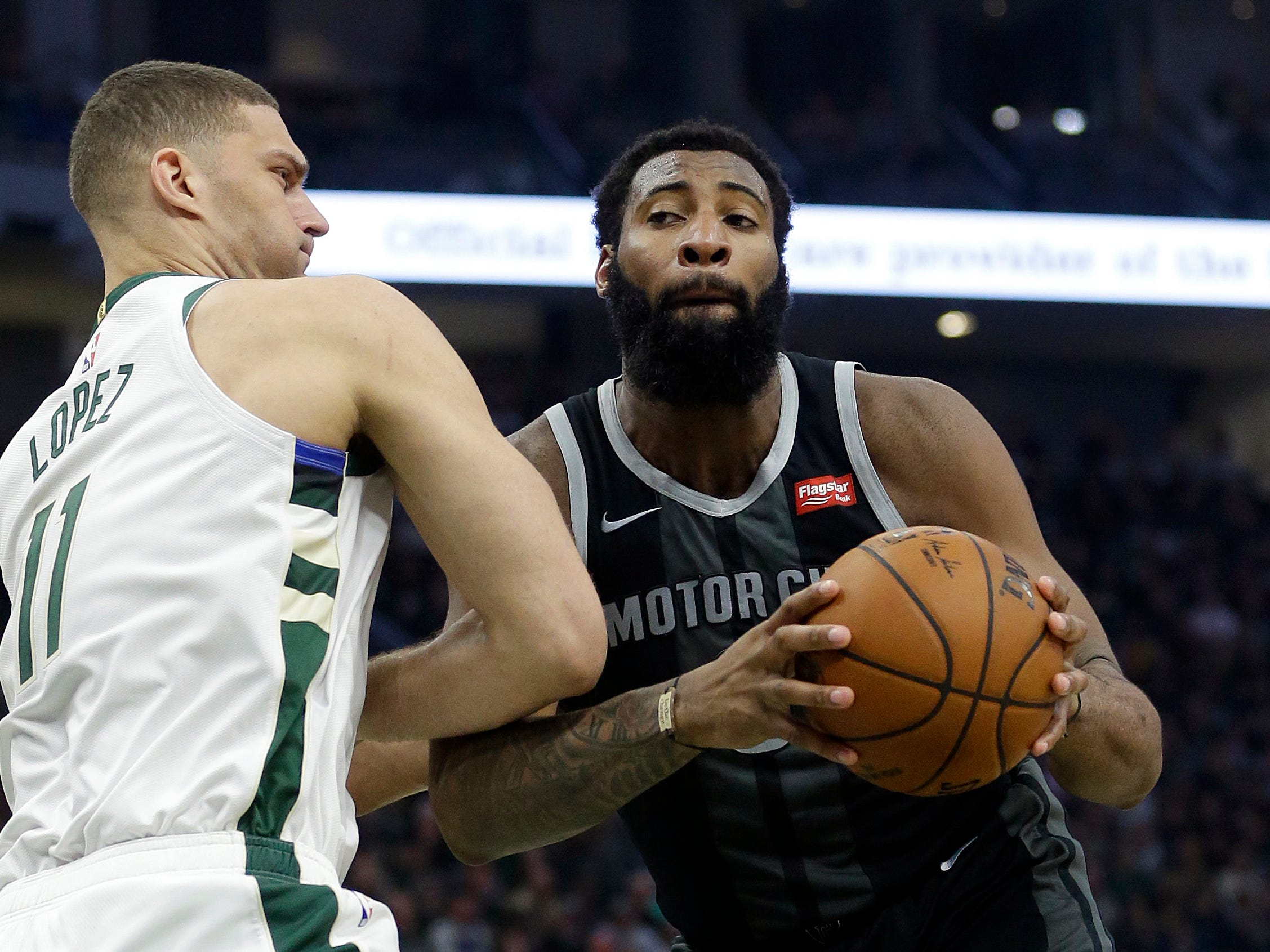 Detroit Pistons' Andre Drummond drives to the basket against Milwaukee Bucks' Brook Lopez during the first half.
