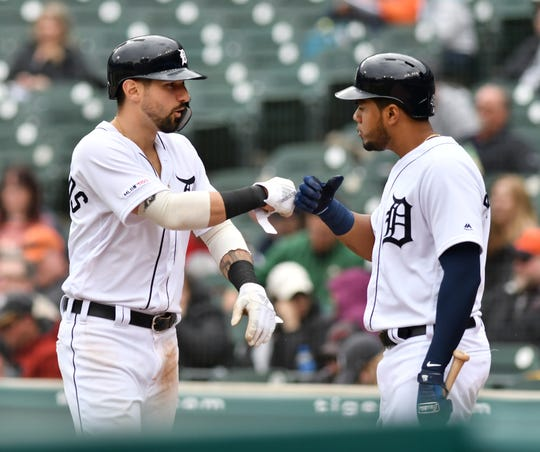 Tigers third baseman Jeimer Candelario, right, congratulates Nicholas Castellanos after he scores in the seventh inning on Thursday.