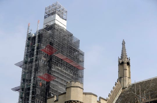 In this photo taken on Wednesday, April 17, 2019, Britain's Elizabeth Tower which houses the clock Big Ben is covered in scaffolding, in London.