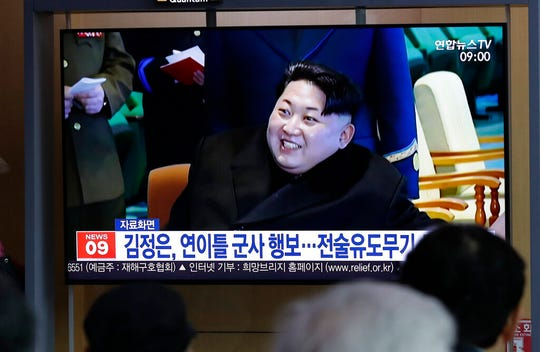 """People watch a TV news program reporting North Korea's test-fire of a """"new-type tactical guided weapon,"""" with a file footage of North Korean leader Kim Jong Un, at the Seoul Railway Station in Seoul, South Korea, Thursday, April 18, 2019."""