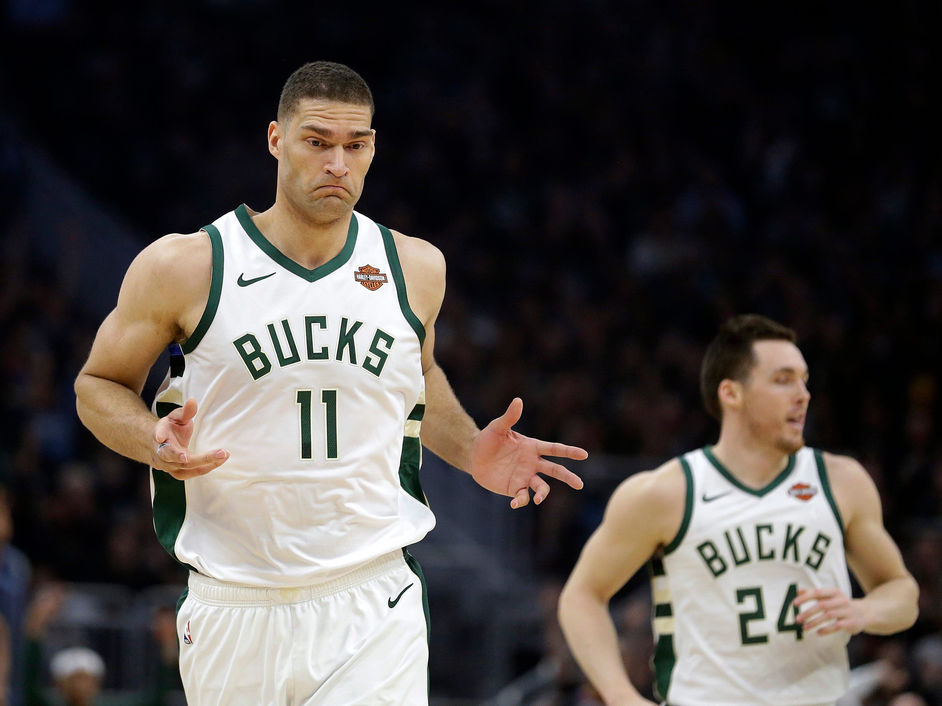 Milwaukee Bucks' Brook Lopez (11) reacts after making a 3-point basket during the first half of Game 2.