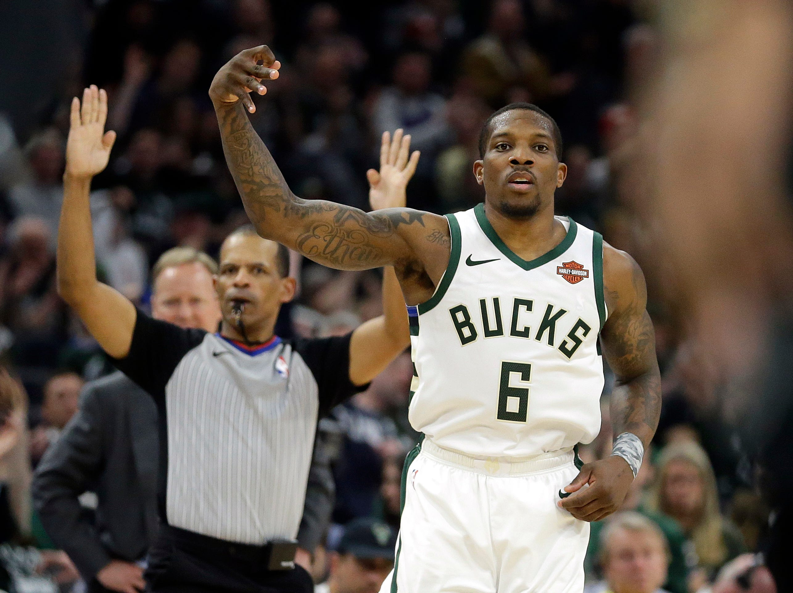 Milwaukee Bucks' Eric Bledsoe reacts after making a shot during the second half.