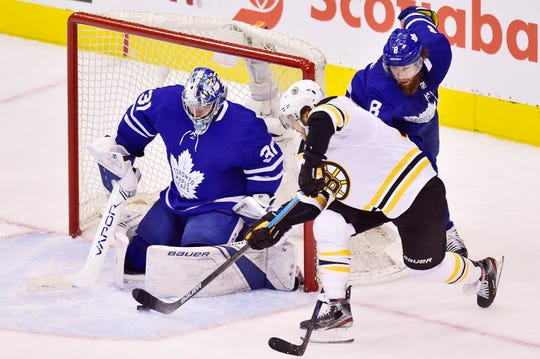 Boston Bruins right wing David Pastrnak shoots on Toronto Maple Leafs goaltender Frederik Andersen during the third period.