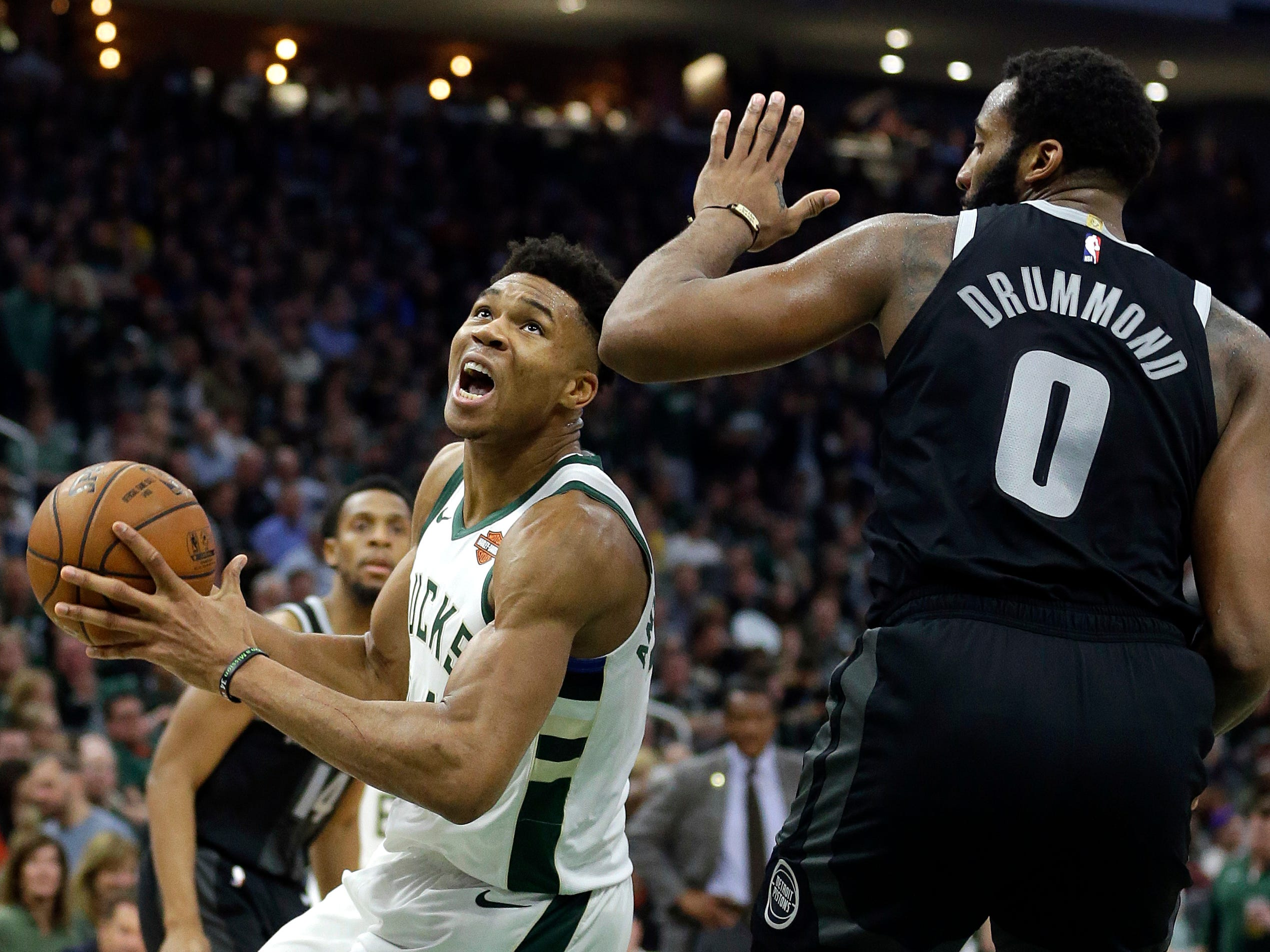 Milwaukee Bucks' Giannis Antetokounmpo drives to the basket against Detroit Pistons' Andre Drummond during the second half.