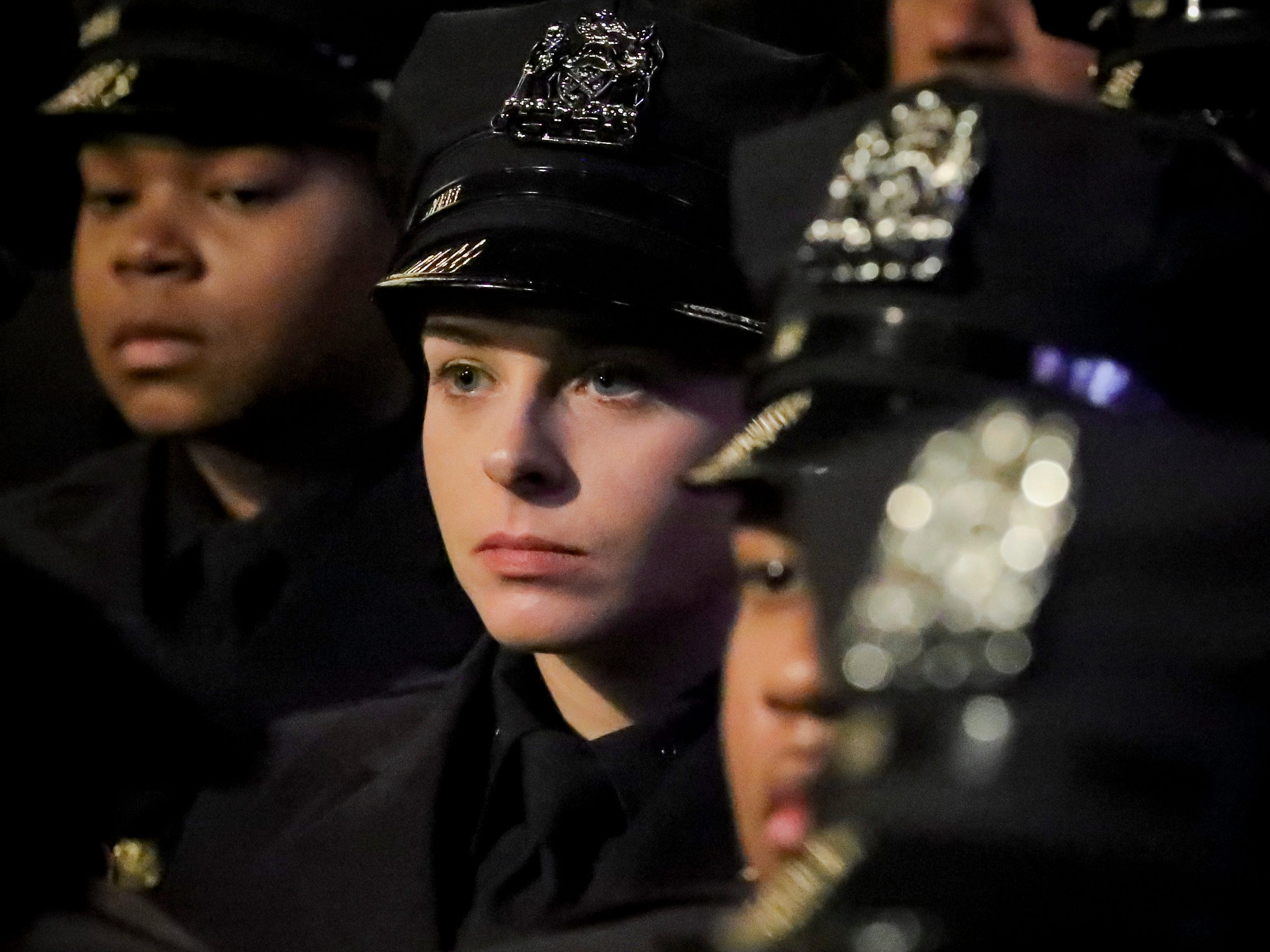 New York City Police Academy graduates listen during their graduation ceremony, adding 457 new members of the NYPD, Thursday April 18, 2019, in New York.