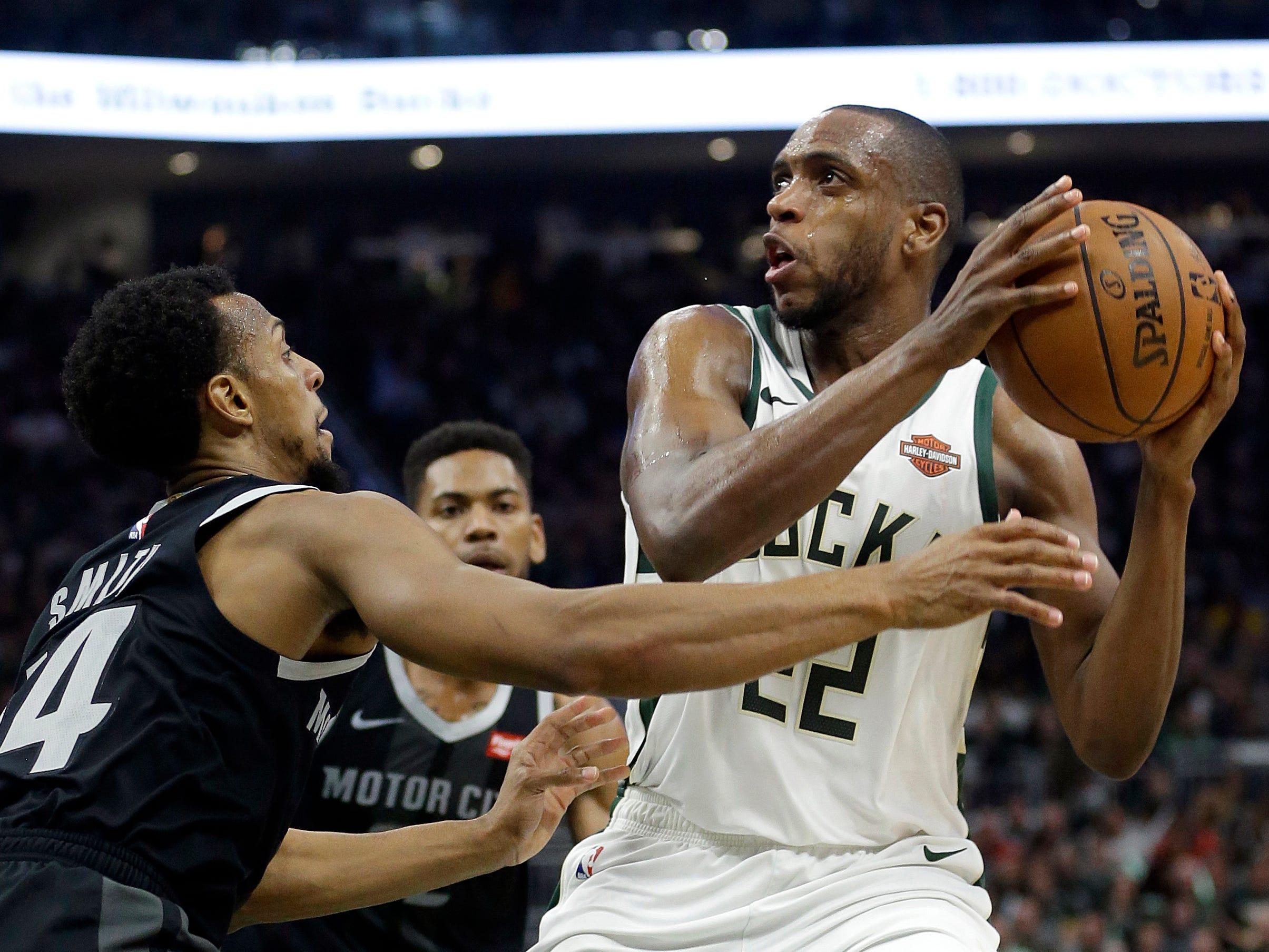 Milwaukee Bucks' Khris Middleton shoots against Detroit Pistons' Ish Smith during the second half.