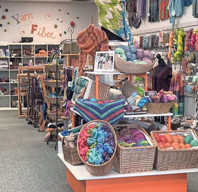 A well-stocked display of merchandise inside Threadbender Yarn Shop in Grandville.