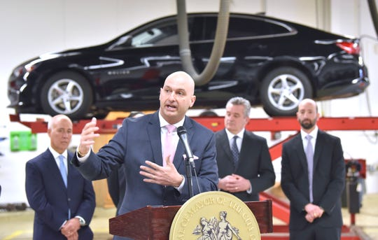 DPSCD Superintendent Dr. Nikolai Vitti addresses attendees at the celebration of the $10 million revitalization of the Breithaupt Career Technical Center, Thursday, April 18, 2019.  Behind him is a Chevy Malibu used by auto shop students to run diagnostics and learn automobile functions.
