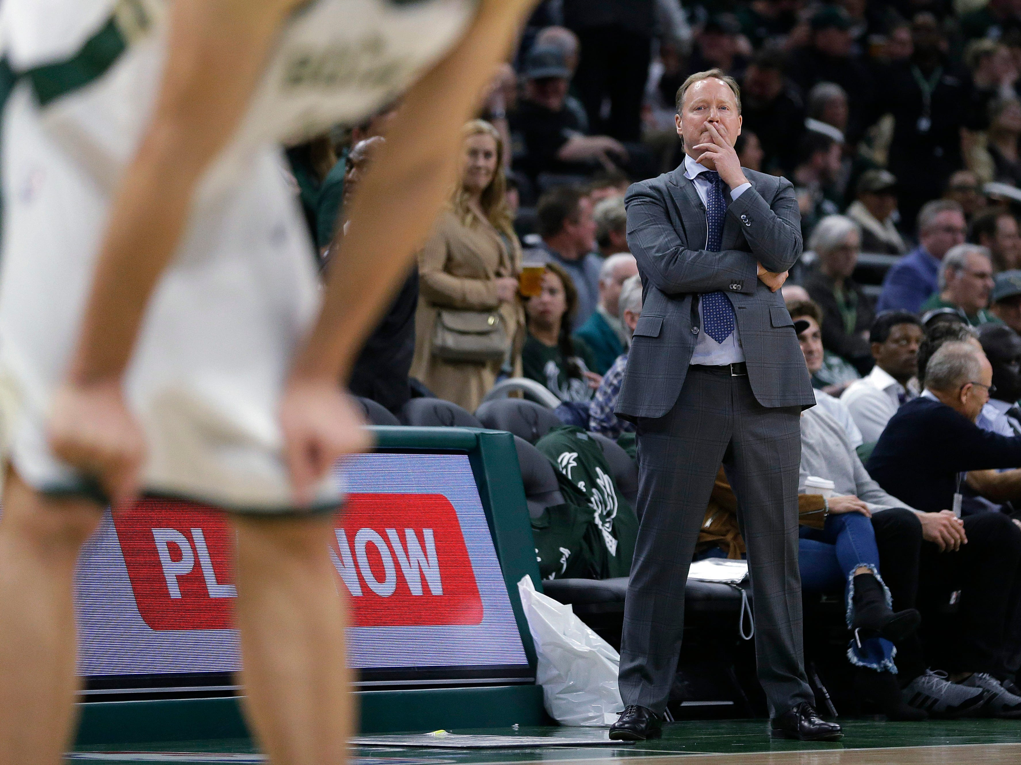 Milwaukee Bucks coach Mike Budenholzer watches from the sideline during the second half.