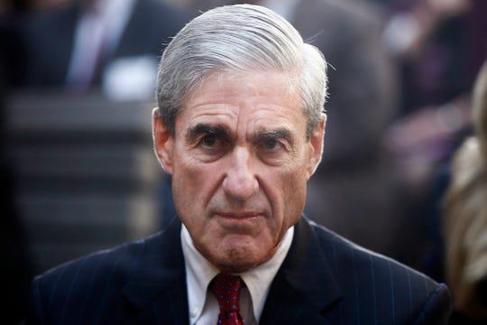 Former FBI Director Robert Mueller is seated at FBI Headquarters in Washington.