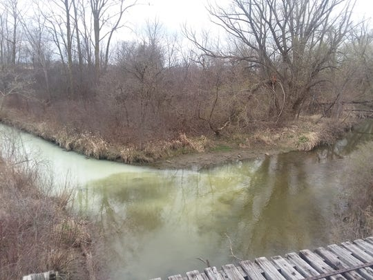 Crews are working to keep the substance found Thursday from traveling downstream.
