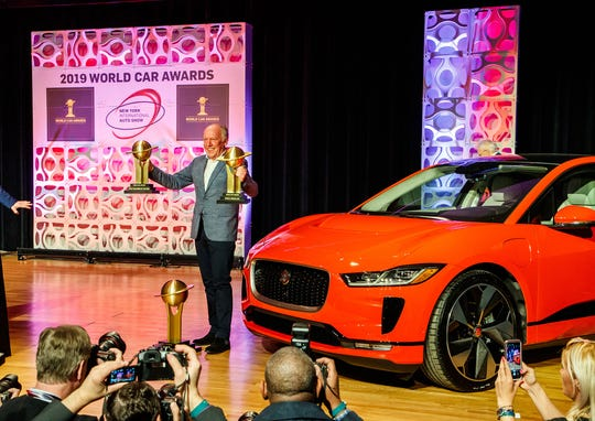 Ian Callum, design director for Jaguar, accepts awards for the I-Pace electric vehicle at the 2019 World Car Awards ceremony during the New York Auto Show.