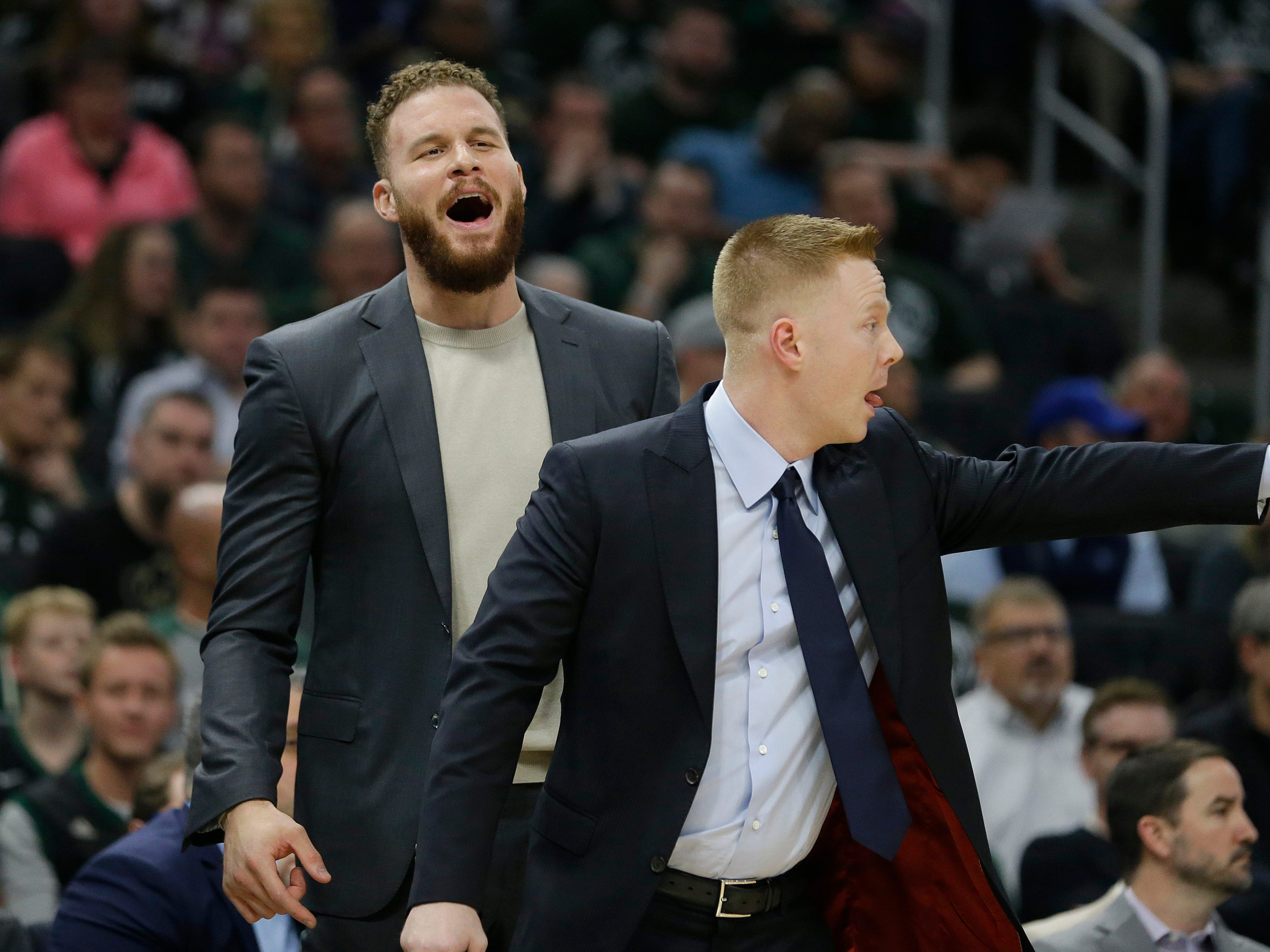 Detroit Pistons' Blake Griffin, left, reacts from the bench during the first half.