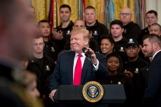 President Donald Trump smiles as he takes the podium at a Wounded Warrior Project Soldier Ride event in the East Room of the White House, Thursday, April 18, 2019, in Washington.